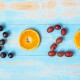 2020 Happy New Year and New You with fruits, Black grapes, Orange, Red grapes on blue wood background. Goals, Healthy, Healthcare, Resolution, Time to New Start, fitness and dieting concept.