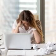 Stressed female entrepreneur in creativity crisis